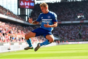 COLOGNE, GERMANY - AUGUST 29: Lewis Holtby of Hamburg celebrates after he scores the opening goal during the Bundesliga match between 1. FC Koeln and Hamburger SV at RheinEnergieStadion on August 29, 2015 in Cologne, Germany.  (Photo by Lars Baron/Bongarts/Getty Images)