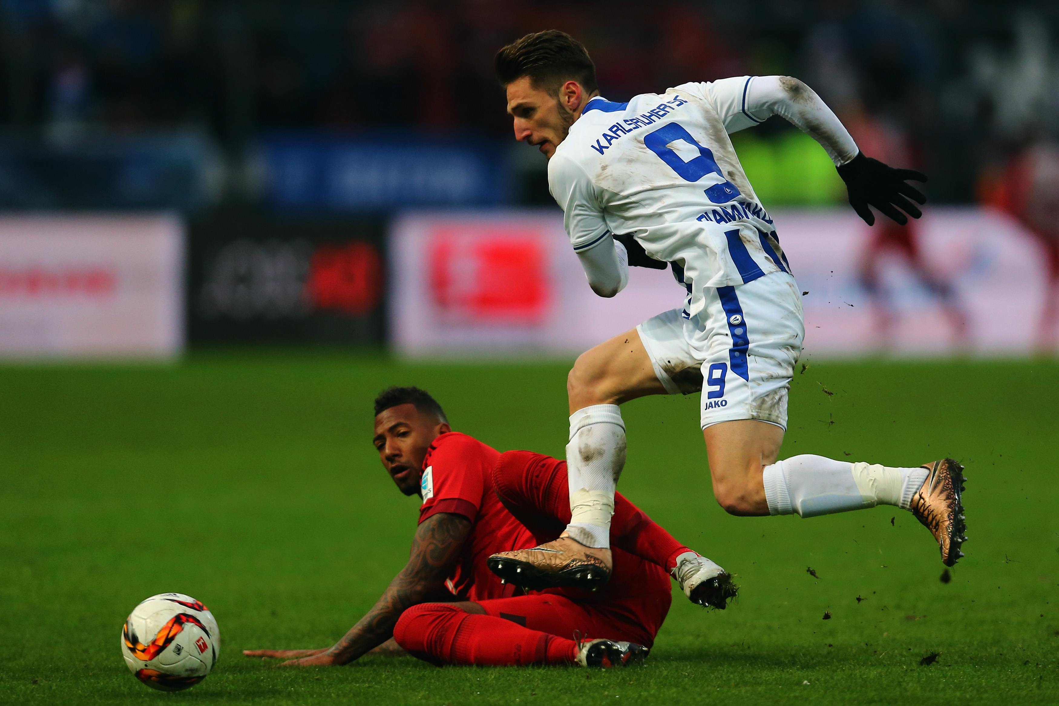 KARLSRUHE, GERMANY - JANUARY 16: Dimitrios Diamantakos of Karlsruhe is challenged by Jerome Boateng of Muenchen during a friendly match between Karlsruher SC and FC Bayern Muenchen at Wildpark Stadium on January 16, 2016 in Karlsruhe, Germany. (Photo by Alex Grimm/Bongarts/Getty Images)