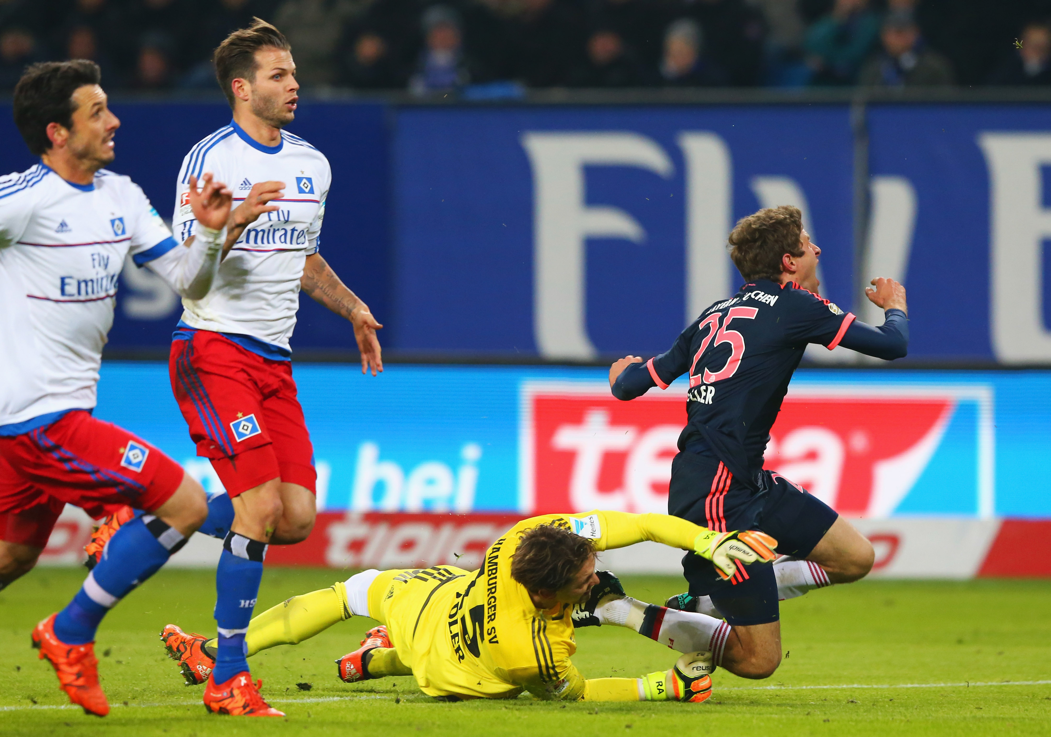 HAMBURG, GERMANY - JANUARY 22: Thomas Mueller of Bayern Munich is fouled by goalkeeper Rene Adler of SV Hamburg for a penalty during the Bundesliga match between Hamburger SV and FC Bayern Muenchen at Volksparkstadion on January 22, 2016 in Hamburg, Germany. (Photo by Martin Rose/Bongarts/Getty Images)